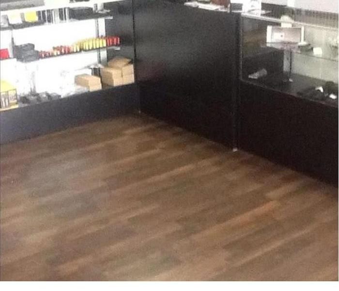 After photo of the retail store with new flooring and contents reset