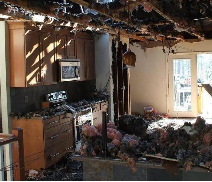 fire damaged kitchen with missing ceiling