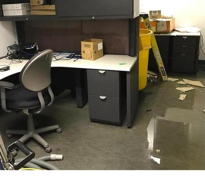 flooded office with fallen ceiling debris