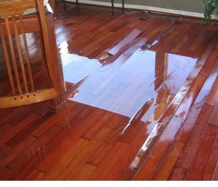 standing water on a wood floor